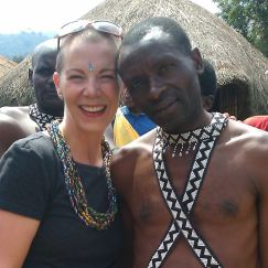 "With my dance ""partner"" in Rwanda."